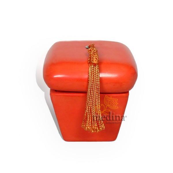 Boite hexaedre tadelakt orange et son pompon de soie