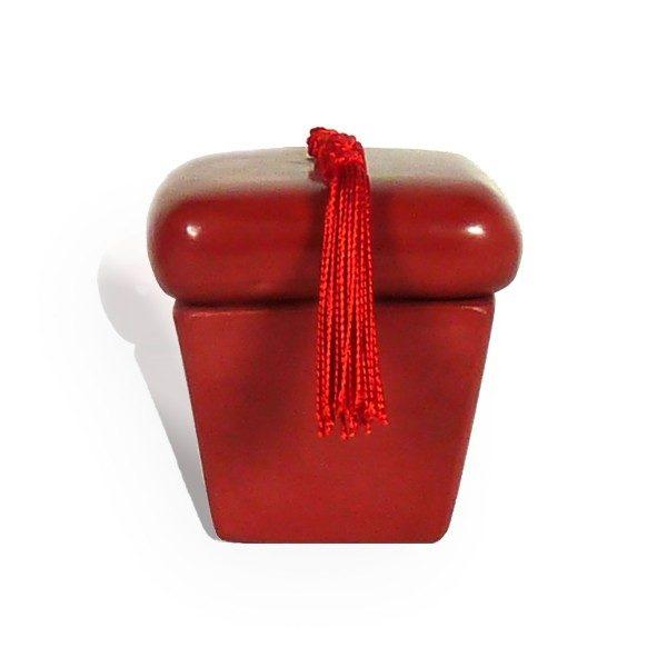 Boite hexaedre tadelakt rouge brique et son pompon de soie